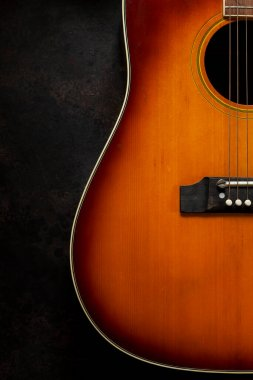Acoustic guitar  on dark brown background