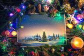Vánoční obrázek s holiday village z rámečku z předmětů