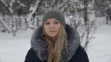beautiful girl portrait in motion in winter