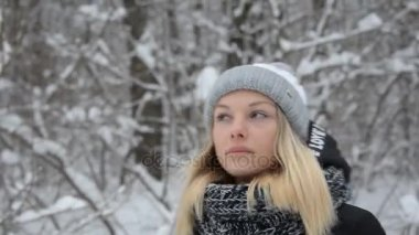 A young girl acts outdoors in the winter