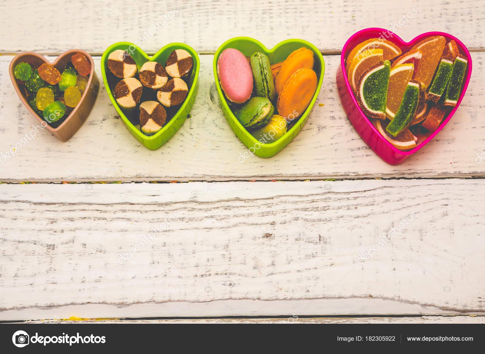 marco de corazones, dulces en el fondo — Foto de stock © studeg.mail ...
