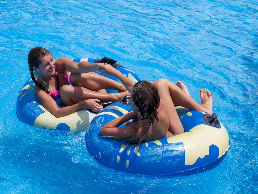 Two teen girls in the swimming pool