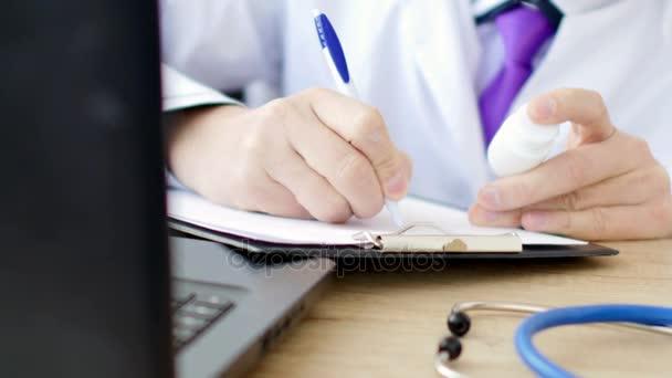 Medical doctor writing prescription. 4K UltraHD video