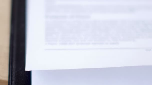 Close-up of stamping in the contract or document. UltraHD video