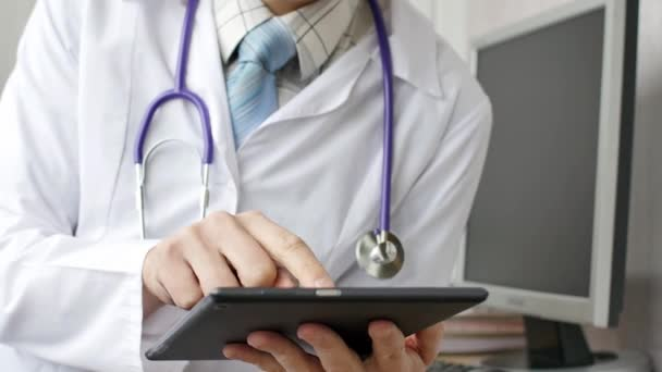 Doctor working with tablet computer.