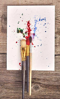 Paintbrushes with painted background