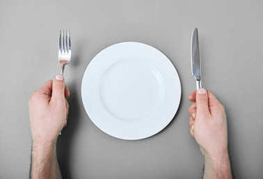 Male hands with cutlery