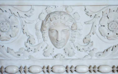 Closeup of Barocco white Bas-relief sculpture on wall