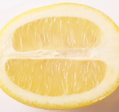 Fresh yellow lemon slice isolated on white background
