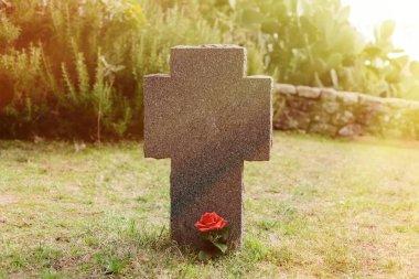 stone cross on cemetery