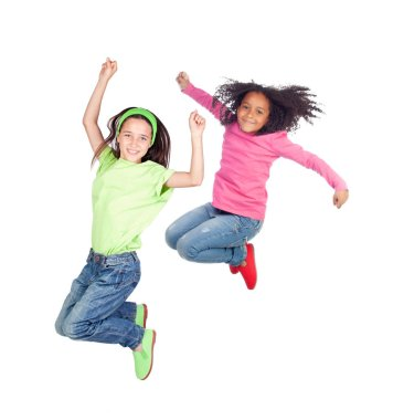 Two little girls jumping