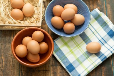 raw eggs in bowls