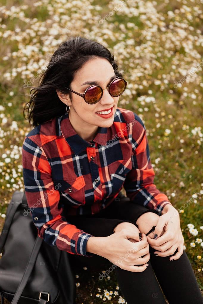 brunette girl in flowery meadow