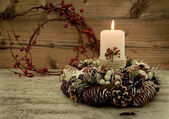 Fotografie Burning candle in Christmas wreath