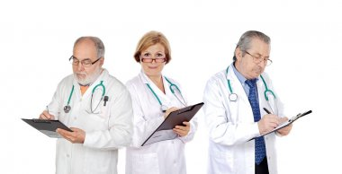mature doctors filling in reports