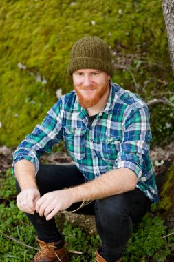 Red bearded man in plaid shirt