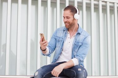 Casual guy listening music