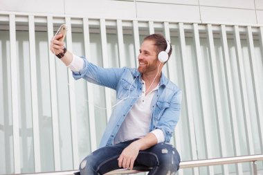 Casual man taking selfie