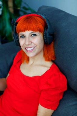 redhead woman listening music