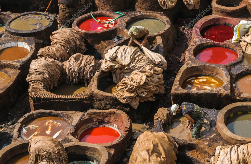 workers washing in vats animal skins