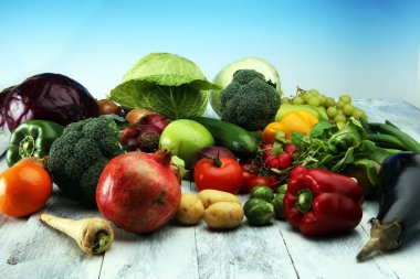 Composition with variety of raw organic vegetables and fruits. B