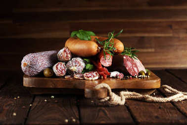 Food tray with delicious salami, ham,  fresh sausages, cucumber