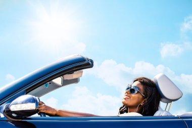 Cute woman in convertible