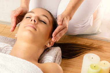 Face shot of woman at reiki session.