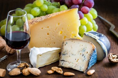 Assortment of cheeses with red wine.