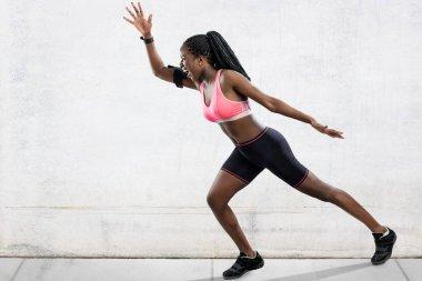 female athlete in running position