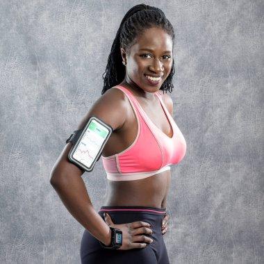 smiling african girl in sportswear