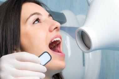 Young woman taking dental x-ray