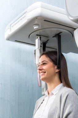 Woman taking 3D dental x-ray