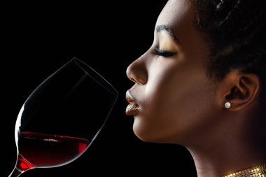 Side view portrait of african woman smelling red wine. stock vector