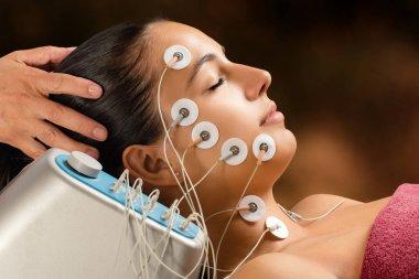 Woman having face lift treatment