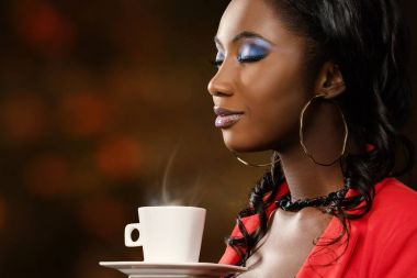 attractive young woman smelling coffee