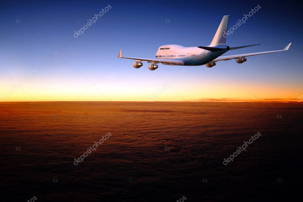 Colorful side and back view image of commercial airplane flying over layer of clouds at dawn. Blank white and blue majestic airbus flying towards skyline.