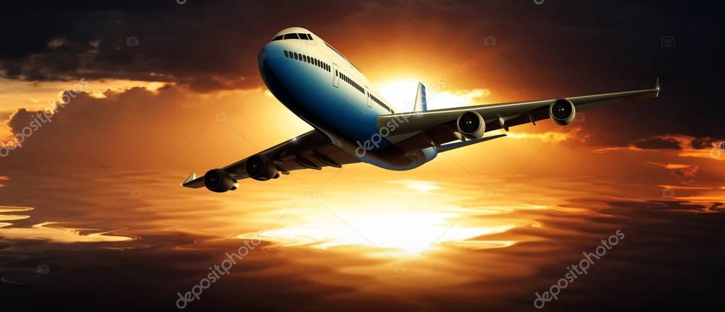 Close up front view of huge jumbo commercial passenger airbus flying over sea at sunset. Dramatic aircraft silhouette against orange reflection on water.