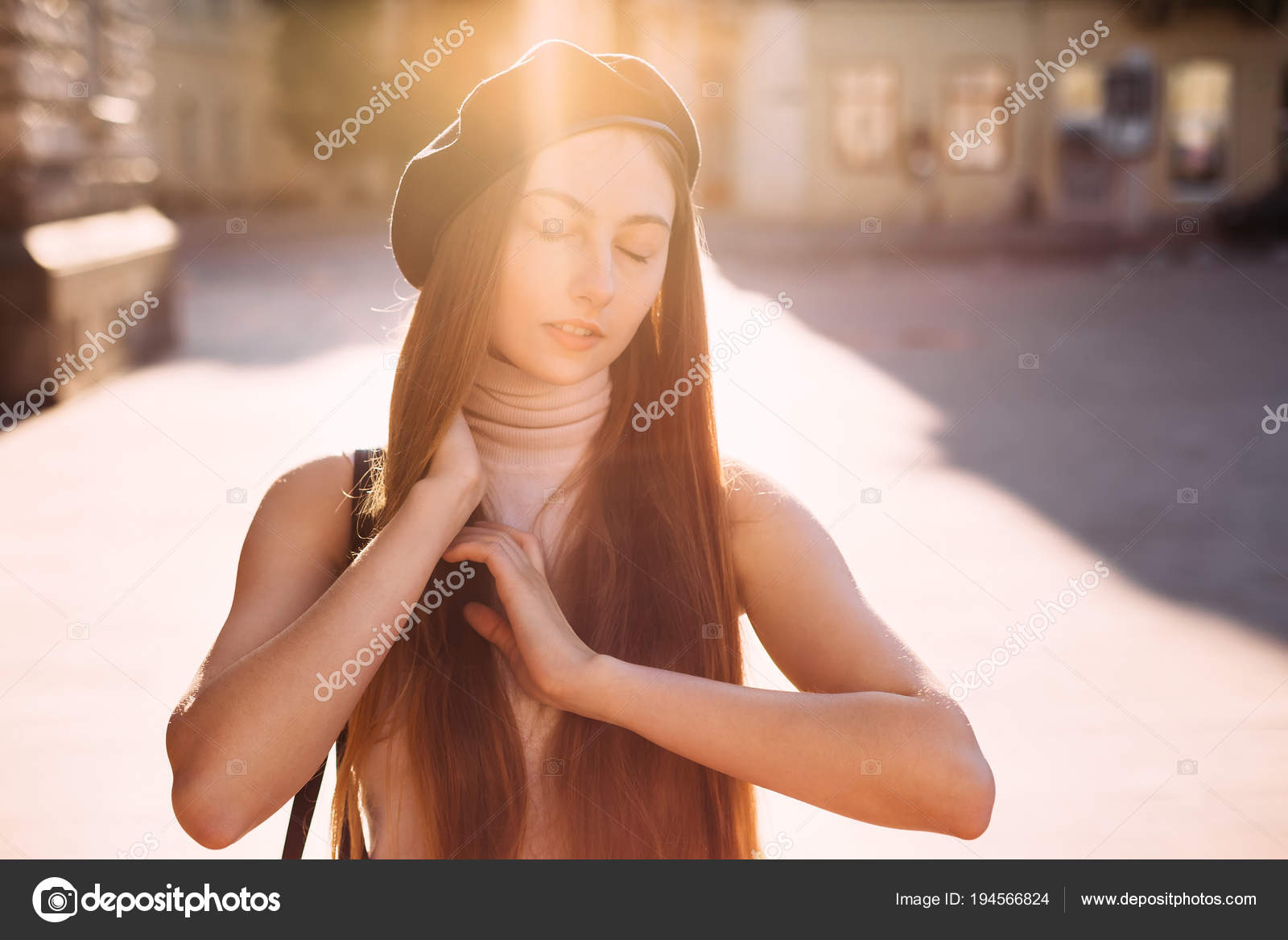 c828941bbcc9e Close-up of a girl with long hair and a black beret that closed her eyes  and the sun s rays fall on it — Photo by ivankyryk