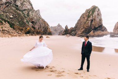 beautiful sandy shore of the ocean and stone cliffs. the bride i