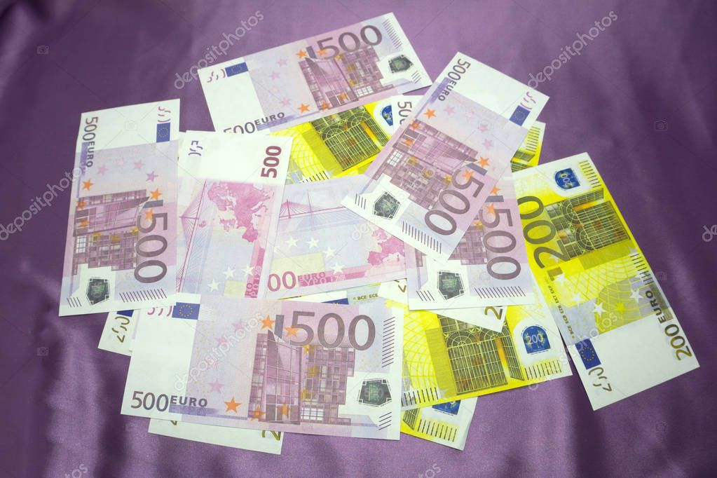 200, 500 Euro notes background texture - mingled pile