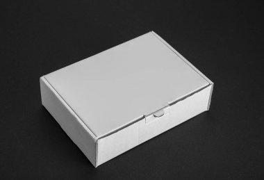 Cardboard paper box on a black background