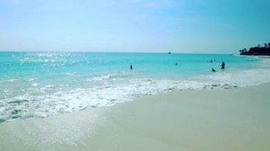 Amazing beauty white sand beach of Aruba Island. Turquoise sea water and blue sky. Beautiful background.