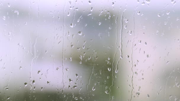 Amazing close up view of raindrops running on window glass. Beautiful nature backgrounds.