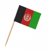 Small paper Afghan flag on wooden stick, isolated on white