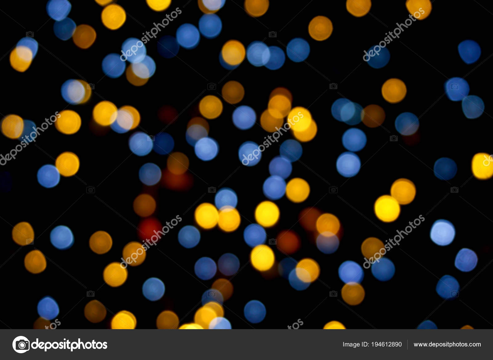 Background and wallpaper colorful abstract with blurred and bokeh of LED party light bubs reflection on black background.