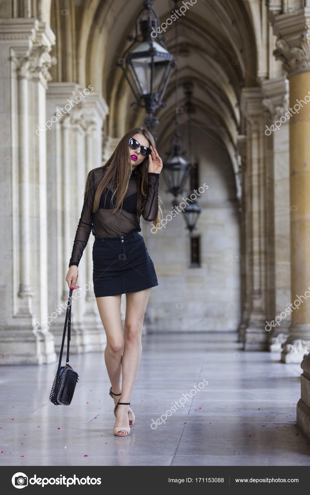 34039627b Beautiful woman wearing mini skirt and transparent top — Stock Photo ...
