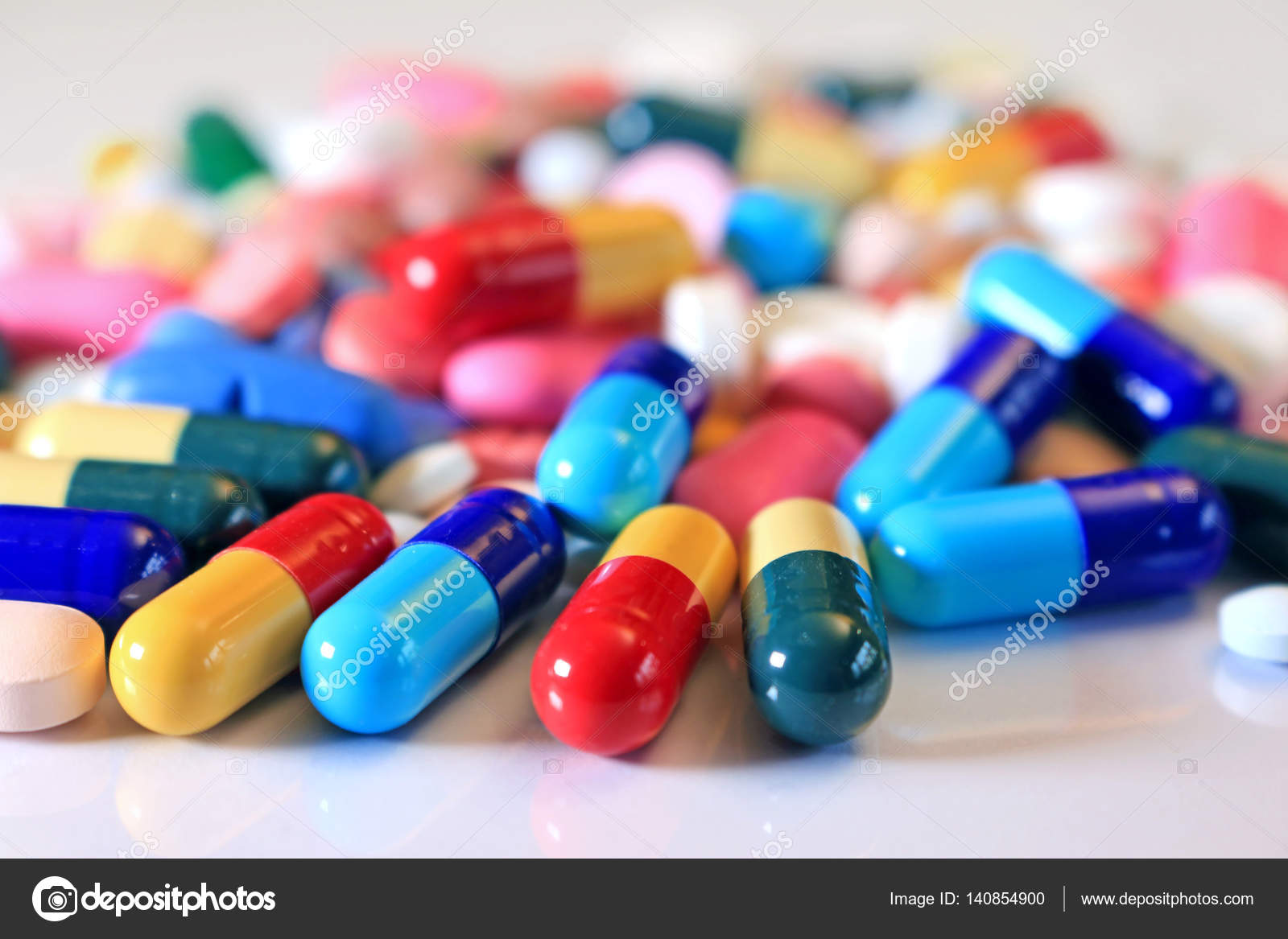 Colorful tablets with capsules — Stock Photo © branex #140854900