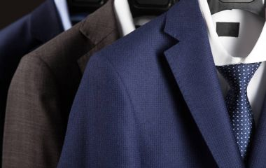Male suits hanging in row