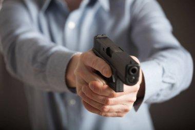 Man holding pneumatic gun